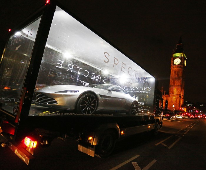 An Aston Martin DB10 - one of ten specially designed and engineered for Spectre - begins a 1,000 mile tour of the UK in a glass truck to celebrate the release of the film on Blu-ray and DVD from 22nd February. The DB10, expected to sell for over £1 million in a Christie's charity auction next Thursday, is touring five UK cities from Monday along with fourteen props and costumes. #SpectreAuction